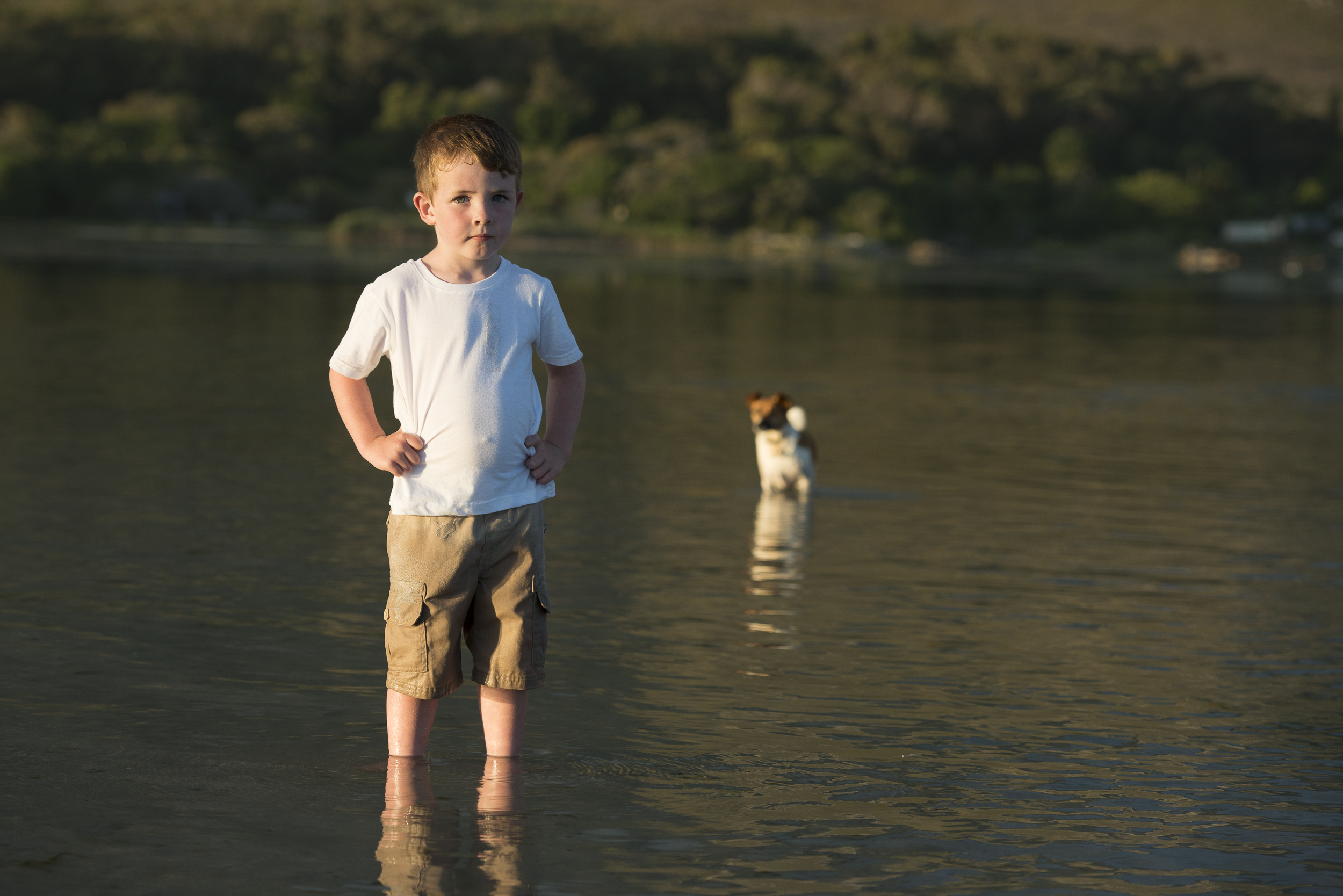 boy and dog in the river
